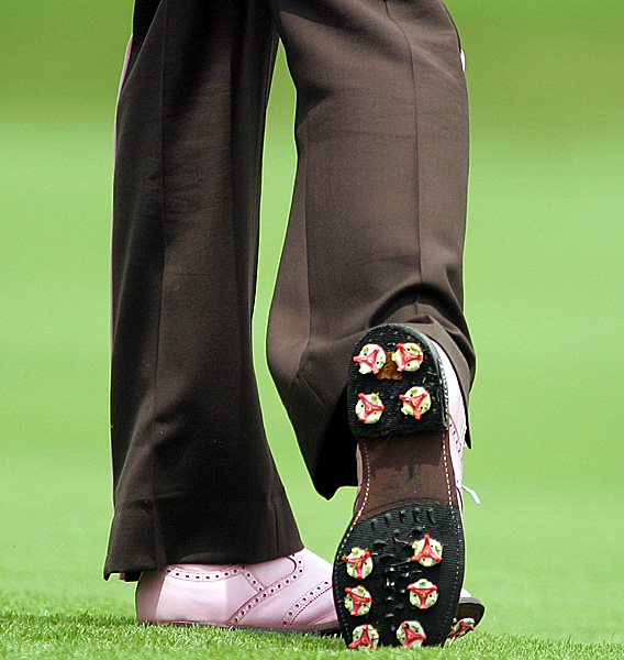Ian Poulter's style extended all the way down to his spikes on Saturday. He shot 72 and is two over for the tournament.