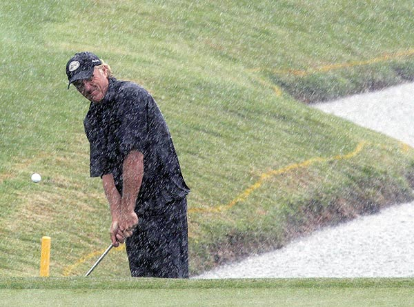 Greg Norman made a rare appearance on tour, battling the elements at TPC Sugarloaf. He is at eight over par.