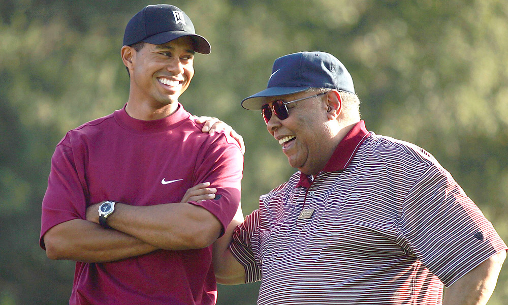 Tiger and Earl Woods                                   Earl Woods, a Green Beret in Vietnam, played with Tiger frequently on military courses in California when Tiger was young.