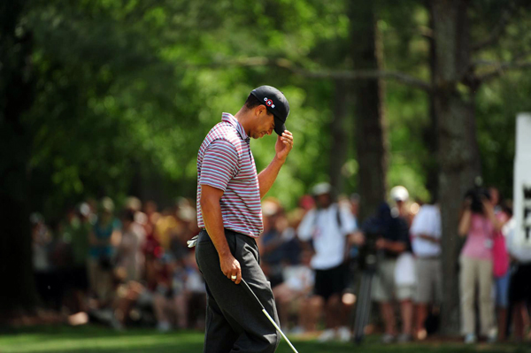 Woods sheepishly walked to the hole after draining a long birdie putt on No. 9.