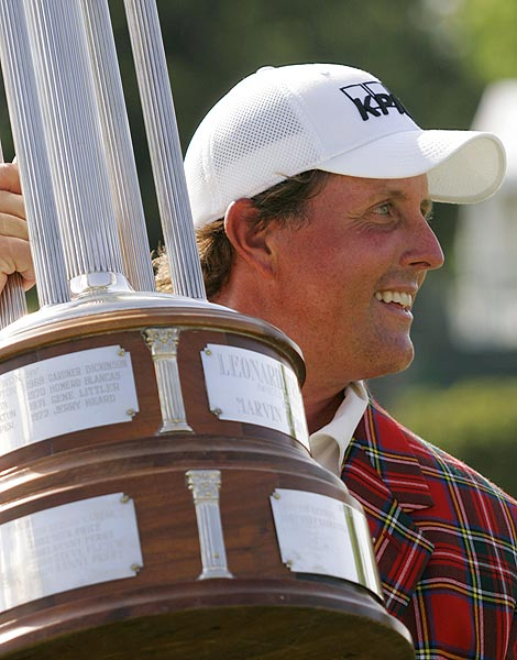 Needing a birdie on 18 to win the Crowne Plaza Invitational at Colonial, Mickelson lobbed a wedge over several trees and made the winning putt for his second victory of the season.