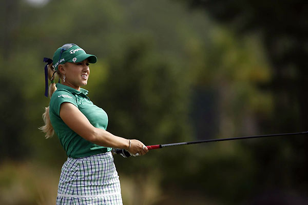 Natalie Gulbis made three birdies, a bogey, and an eagle on the front nine, then she made nine pars on the back nine for a 68.