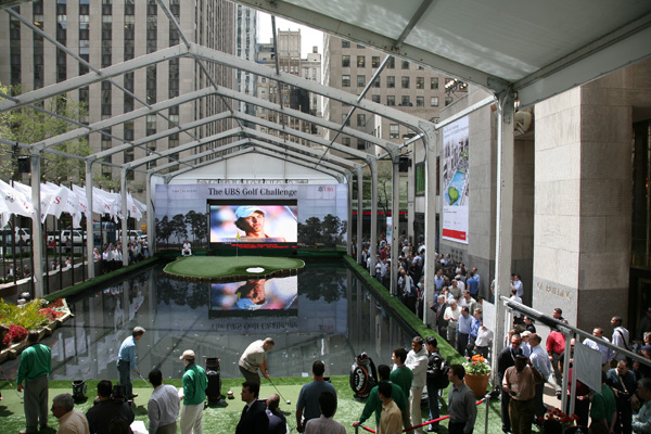Nine hundred and sixty-four miles from Ponte Vedra Beach, Fla., home of the TPC at Sawgrass's terrifying 17th par-3, a quarter-sized replica of the hole opened to the public Friday in Rockefeller Center.                                              To promote next week's Players Championship, the PGA and UBS invited the public to attempt a hole-in-one at the sized-down 17th, which translates to a 30-yard pitch shot from artificial turf.