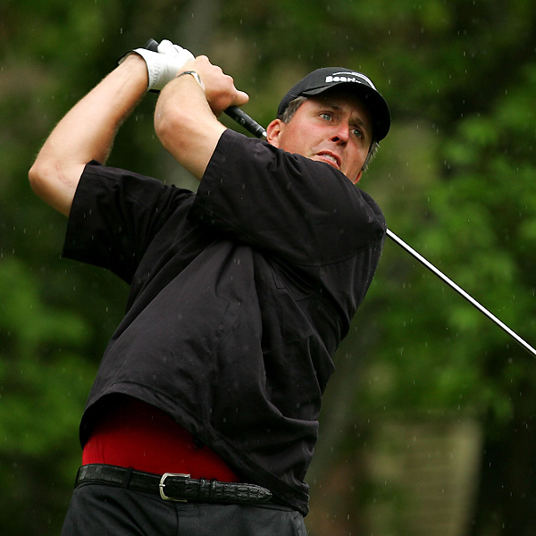 "Phil Mickelson isn't far behind. Lefty shot a one-under 71 and stands at three under. ""I didn't put myself in the best places off the tee,"" Mickelson said. ""I'm going to see if I can get that worked out and straightened out for the weekend.""                                              See the latest news and photos about Phil Mickleson"