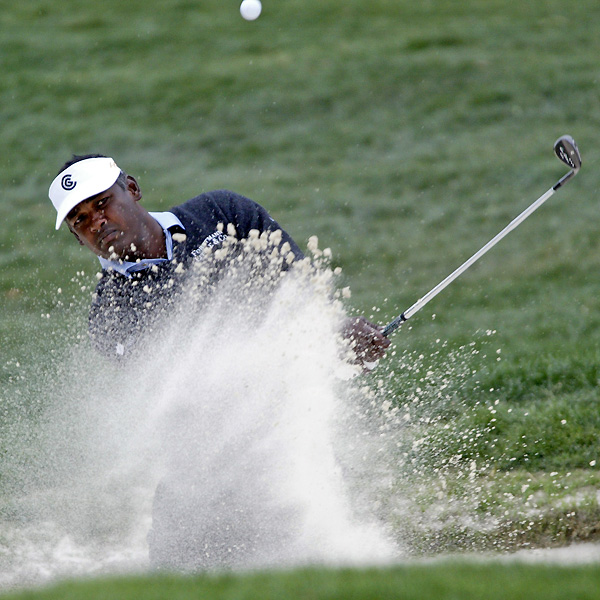 What a round for Vijay Singh. Singh made an eagle and a birdie on the front nine. He then made five bogeys, three birdies and one par on the back nine to shoot a one-under 71 to tie Woods at six under.                                              See the latest news and photos about Vijay Singh