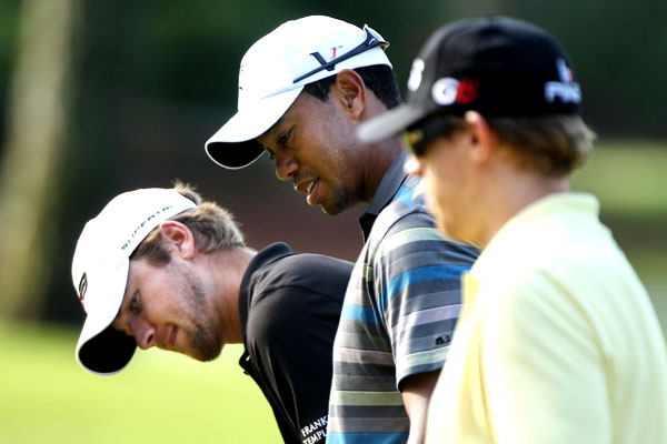 Woods joined Sean O'Hair, left, and Mahan for a practice round Wednesday.