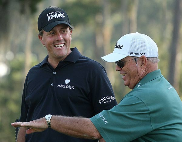 """I feel as though my game is totally different [from this time last year]. I had been in the first month or so of working with Butch, my ball-striking has made leaps and bounds of improvements over the last 12 months,"" Phil Mickelson, here with coach Butch Harmon, said Tuesday. ""I have not had as many wins as I would have liked. I've only won once this year, and I can't look at that as being a long game problem."""