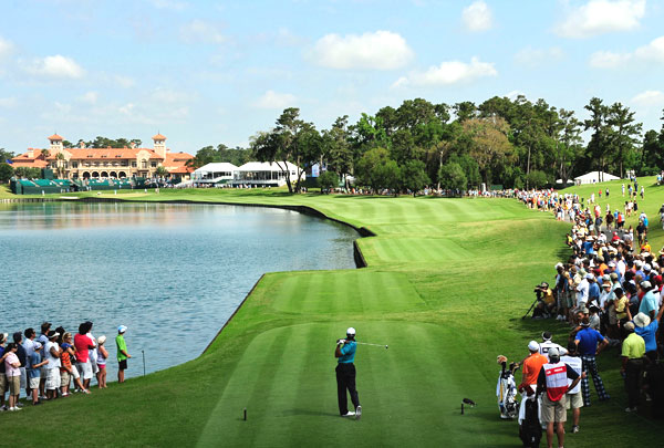 A day after driving in the water on 18, Woods found dry land and made a par.