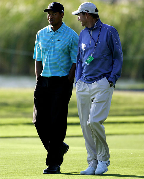 Tiger Woods walked with his coach, Hank Haney, during a practice round Tuesday.                            • See the latest news and photos about Tiger Woods