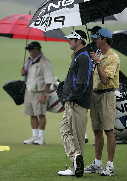 Florida native Bubba Watson stayed dry during his practice round Wednesday.                       • Rain cutting into players' practice time