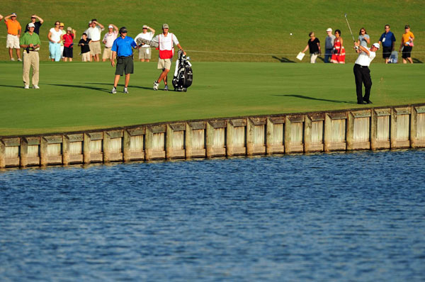 Mickelson's drive on 18 came to rest inches away from the water.
