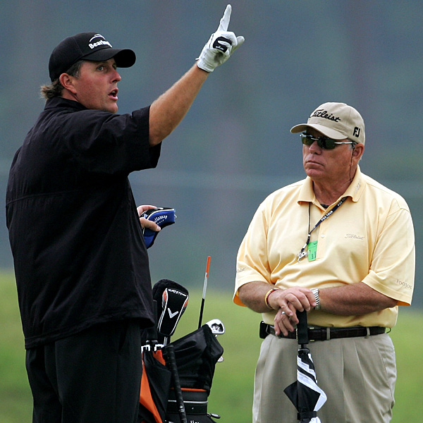 Phil Mickelson with his new coach, Butch Harmon, during Wednesday's practice round.                           • Phil demonstrates kickboxing moves on Funk
