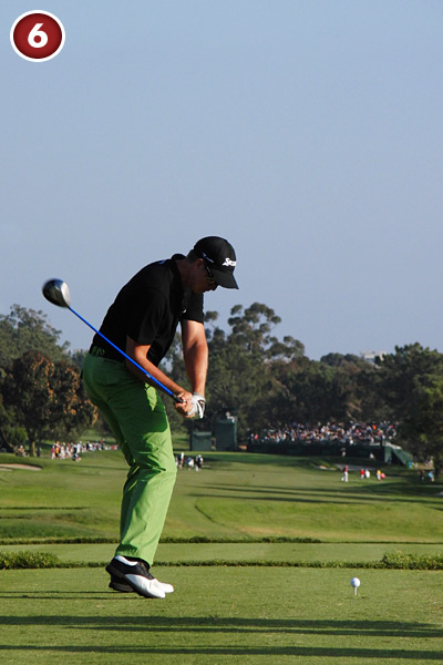 6. Stenson pushes off with his right foot and pulls his left hip up — a combination that helps accelerate the club from the top. Despite all this pushing and pulling, he keeps his address posture.