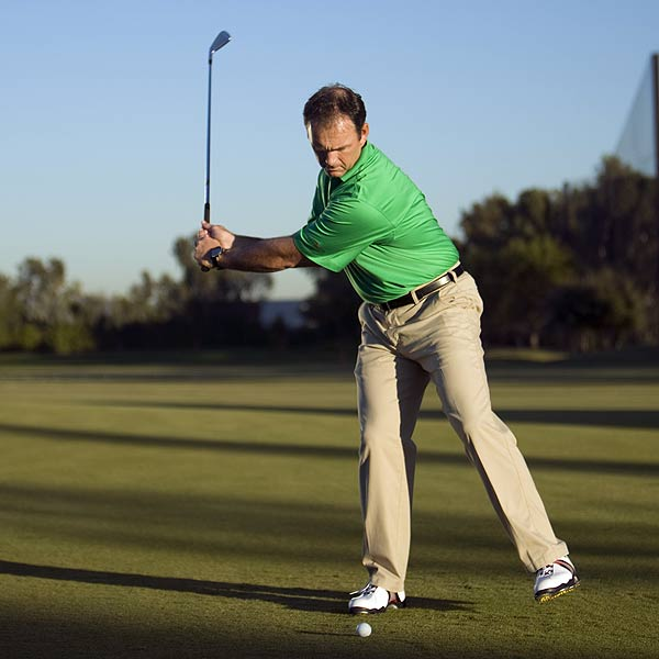 STEP 2                                                      As you take the club away, lift your left leg. When your left arm is parallel with the ground, step toward the target. This is how you create torque (which means power) in your swing.