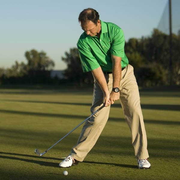 STEP 4                                                      The correct sequence of motion has created a dynamic impact position with the shaft leaning forward. Try this drill a few times and you'll be shocked at how much farther you hit it.