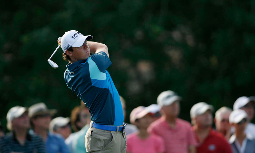 Rory McIlroy fired a solid three-under 67 to trail by one.