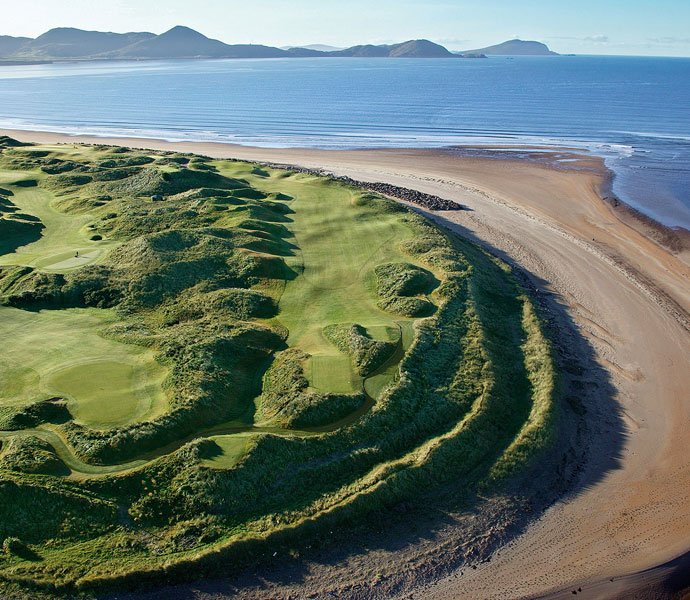 "Graeme McDowell: ""Waterville might be my favorite links course. It's a great track with rugged dunes and beautiful views of the mountains and Ballinskelligs Bay. You just feel like you're on another planet, cut off from the rest of the world, out there on the southwest tip of Ireland. And they serve a great pint of Guinness.""                                                      Pictured: Waterville's No. 16, called ""Liam's Ace."""