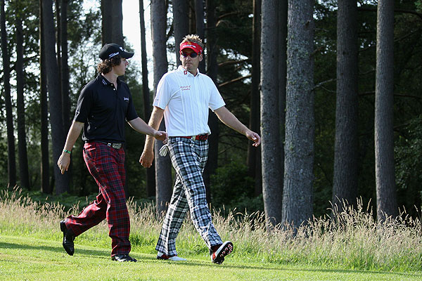 Ian Poulter and Rory McIlory played in coordinating outfits, shooting 69 and 68 respectively.