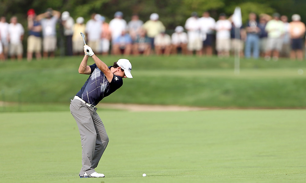 McIlroy also birdied the 18th to reach 12 under, one back of leader Vijay Singh.