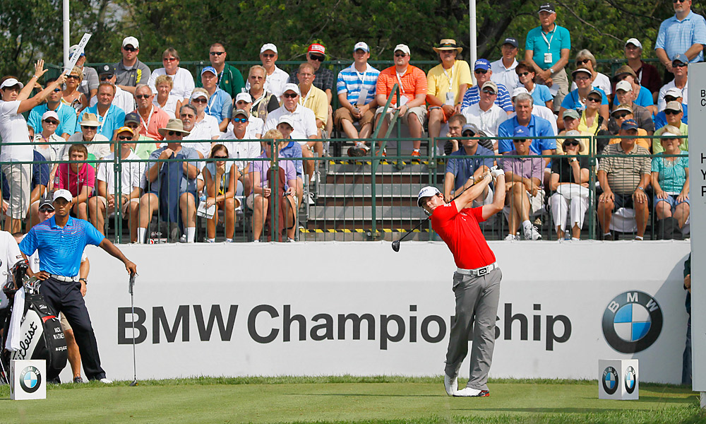 McIlroy played even better than Woods, finishing with a 64 and a share of the lead with Webb Simpson, Bo Van Pelt and Graham DeLaet.