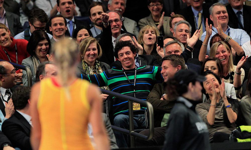 Rory McIlroy was in New York City Monday to watch girlfriend Caroline Wozniacki (foreground) play Maria Sharapova at the BNP Paribas Showdown.