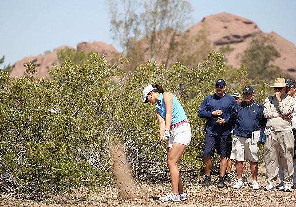 Wie made back-to-back bogeys on Nos. 15 and 16.