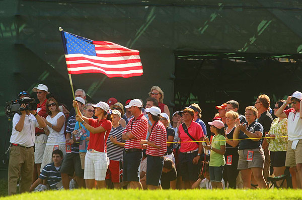 Wie followed her teammates with an American flag after finishing her match.