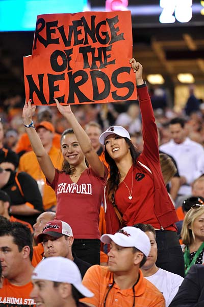 Stanford Cardinal Michelle Wie and another fan hold up a sign in the third quarter of a game against the Oklahoma State Cowboys in the 2012 Fiesta Bowl at University of Phoenix Stadium.  The Cowboys won 41-38 in overtime.