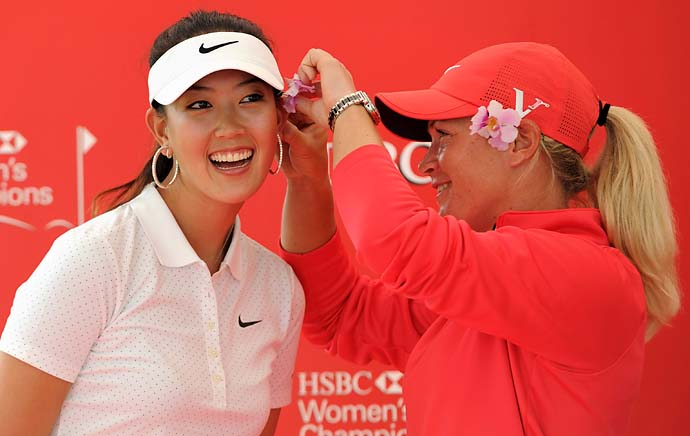 Suzann Pettersen places an orchid on Michelle Wie at the  HSBC Women's Champions 2012 in Singapore on Feb. 21, 2012.