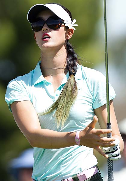 Michelle Wie sports a green ponytail during the first round of the 2012 Kraft Nabisco Championship.