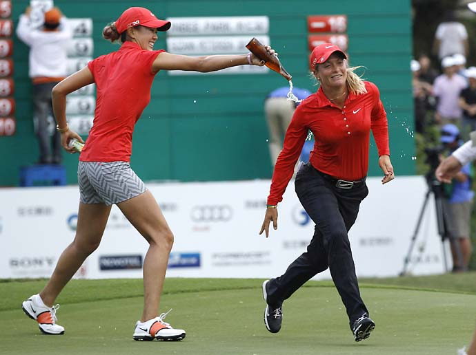 Michelle Wie pours beer on Suzann Pettersen after Pettersen won the Taiwan Championship at the Sunrise Golf & Country Club, on Oct. 28, 2012, in Yang Mei, Taiwan.
