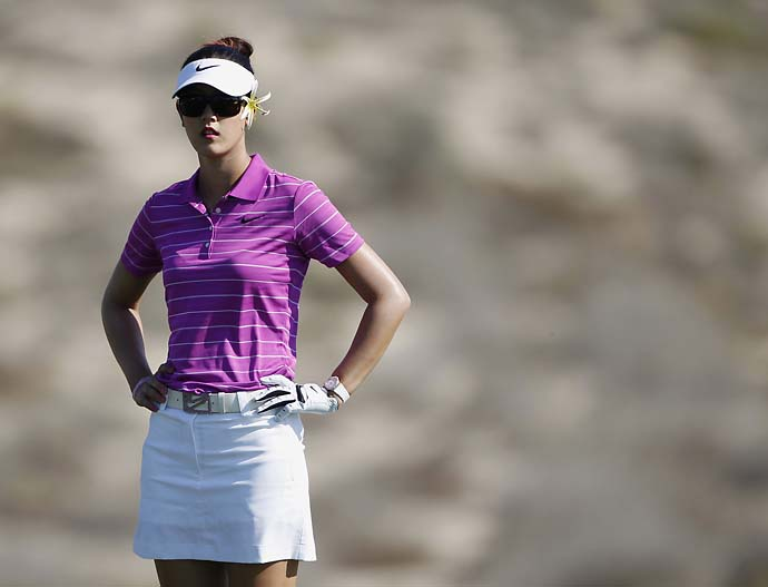 Michelle Wie looks on at the eighth green during the third round of the Dubai Ladies Masters European Tour at the Emirates golf club in Dubai Dec. 16, 2011.