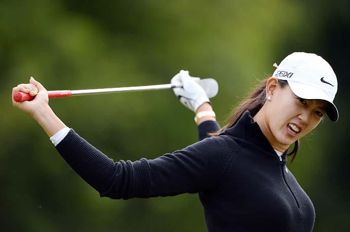 Michelle Wie stretches before the 2013 Evian Championship in Evian, France.