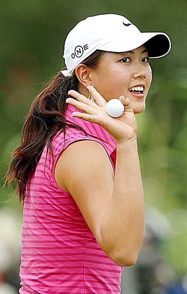 Michelle Wie greets the audience during the final round of the 2006 Evian Masters golf tournament as part of the LPGA Championship, held at Evian Royal Resort Golf Club in the French Alps. Wie finished T2 behind Karrie Webb.