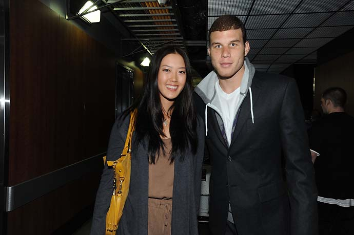 Michelle Wie with Blake Griffin of the Los Angeles Clippers after a game against the Phoenix Suns at Staples Center on March 20, 2011 in Los Angeles.