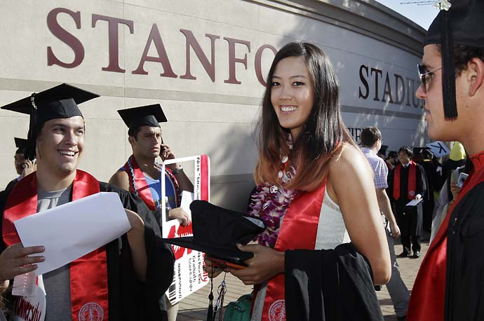 Michelle Wie smiles as she graduates from Stanford University during ceremonies in Stanford, Calif., on June 17, 2012.