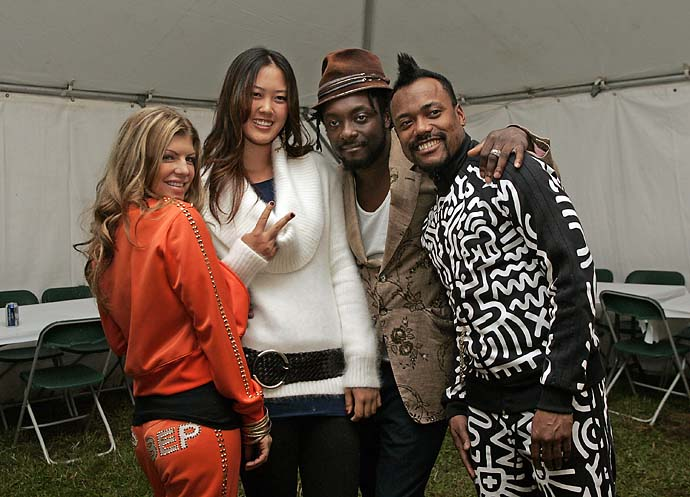 Michelle Wie poses with Fergie, will.i.am and apl.de.ap of Black Eyed Peas before the Black Eyed Peas concert after the third round of the 84 Lumber Classic held on the Mystic Rock Course at Nemacolin Woodlands Resort & Spa in Farmington, Pa., on Sept. 16, 2006.