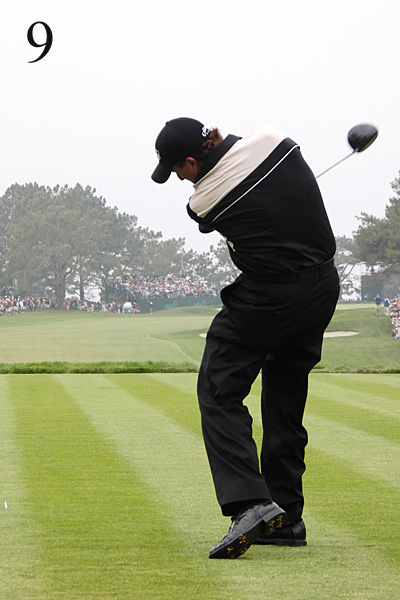 9. Check out how low Phil's club exits the hitting zone — It should extend out toward the target instead of immediately moving right after impact. And you rarely see a bent lead leg on Tour anymore. His swing is a throwback.