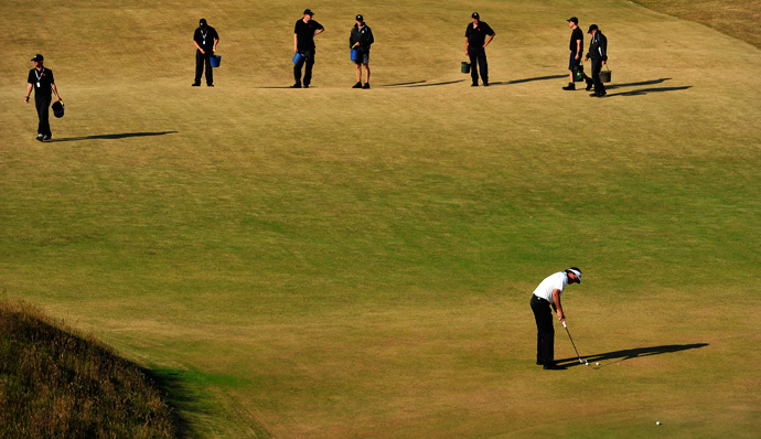 The grounds crew at Muirfield stopped to watch Phil Mickelson practice.