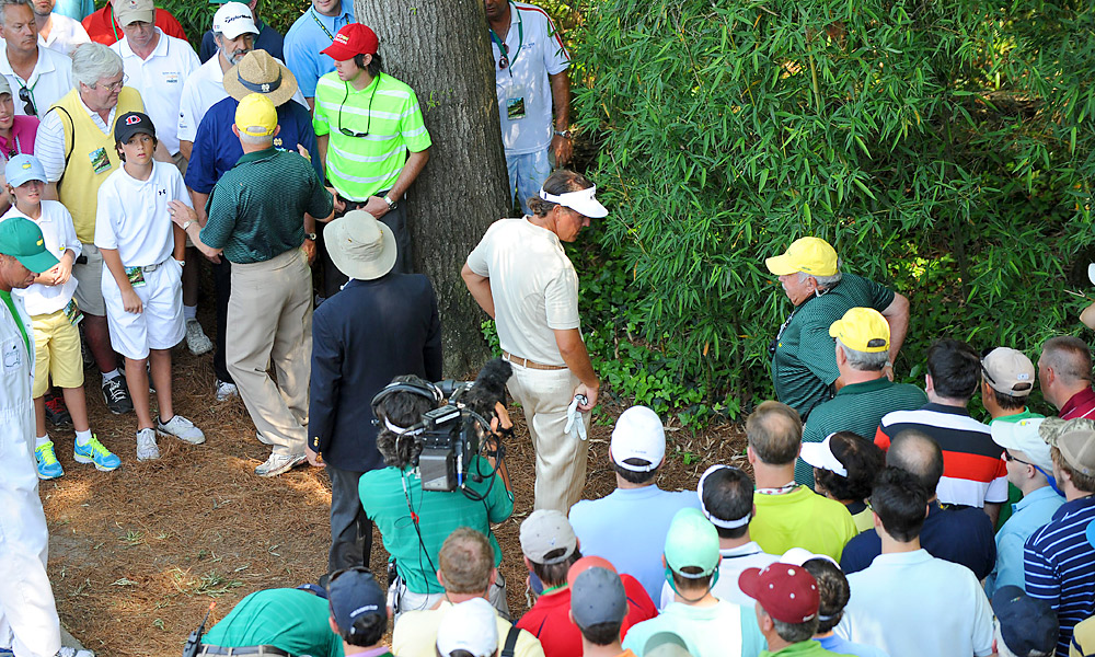Heading into the final round of the Masters, Phil Mickelson was the favorite to win his fourth green jacket, but his hopes were dashed on the par-3 fourth hole. Mickelson was focused on keeping his tee shot left of the pin, which brought the grandstands into play. If he found the stands, the rules would work in his favor, giving him a free drop near the green. Sure enough, he knocked his shot into the crowd, but instead of staying put, his ball caromed off a railing and into the woods behind a bush. After some ugly, right-handed swipes at the ball, Mickelson finished with a triple bogey and his lead was gone.
