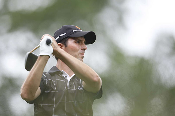 Mike Weir gave back four strokes Sunday afternoon, dropping to two under par.