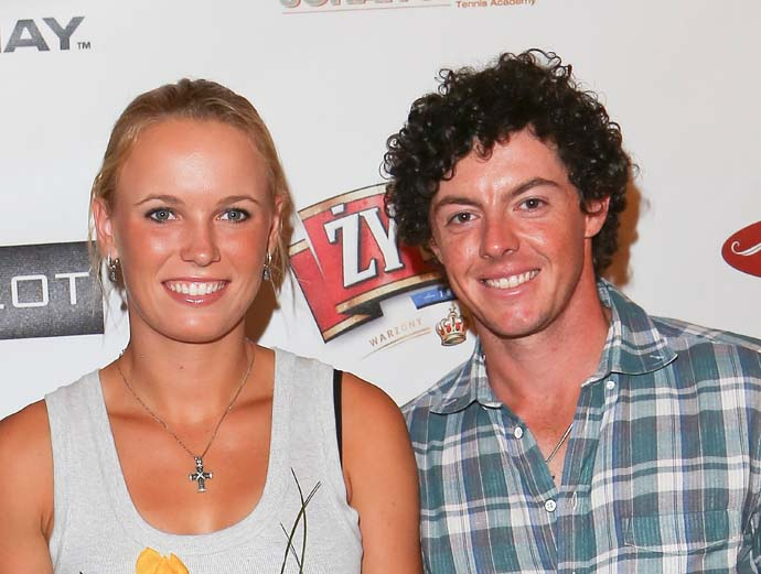 """I think he's in love for the first time. It's a wonderful feeling, and it's distracting.""                           --Johnny Miller on strugging Rory McIlroy [in photo with girlfriend Caroline Wozniacki]."