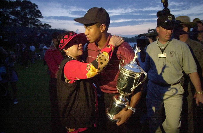 Tiger Woods holds his trophy and embraces his mother, Kultida Woods, after winning the U.S. Open at the Black Course of Bethpage State Park in Farmingdale, N.Y., on June 16, 2002.