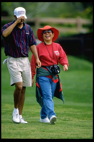 Tiger Woods walks with his mother, Kultida, in March 1996.