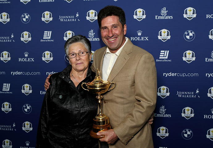 Team Captain Jose Maria Olazabal and his mother, Julia, pose with the Ryder Cup as the European team departs for the Ryder Cup from Heathrow Airport on Sept. 24, 2012, in London, England.