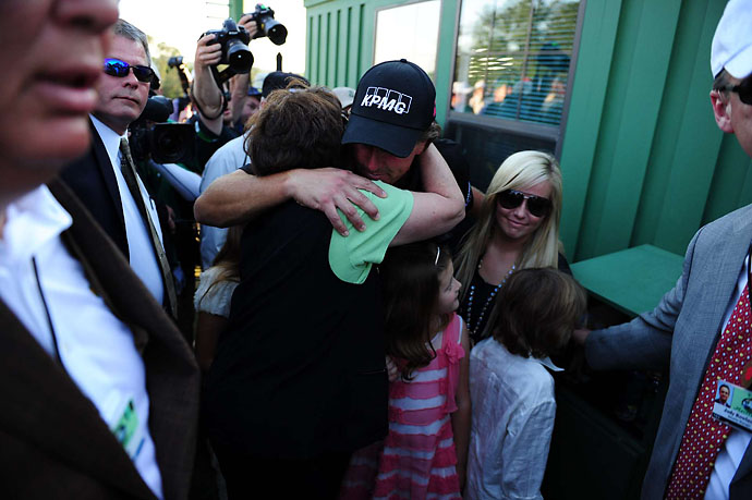 Phil Mickelson hugs his mother after winning the 2010 Masters.