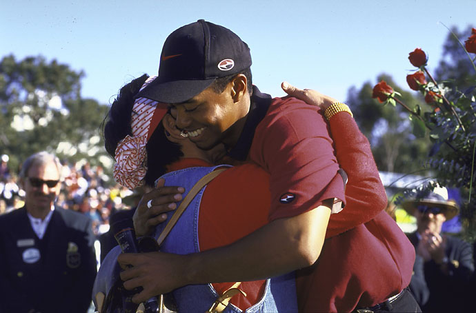 Tiger Woods hugs his mother, Tida, after winning the Buick Open in February 1998.