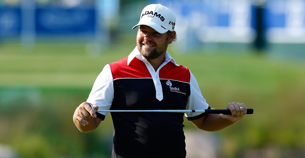 Ryan Moore just missed a birdie putt on 18 for 63. He had to settle for a 64.