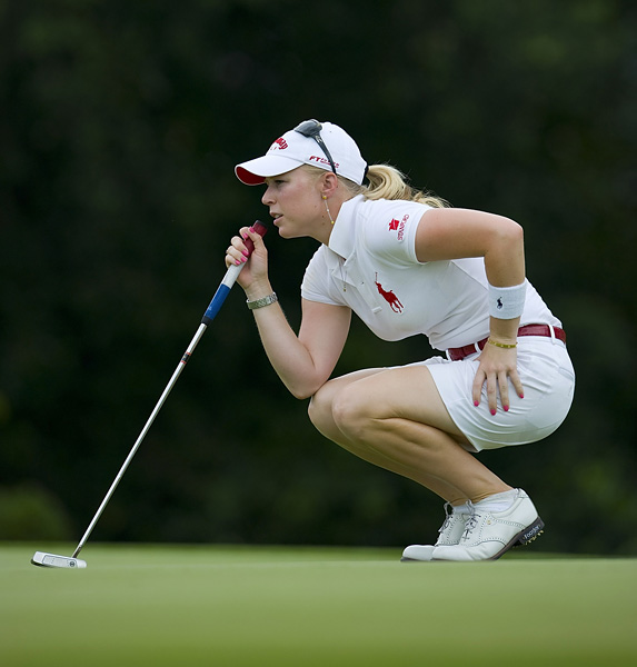 Solheim Cup Record: 1-2-1