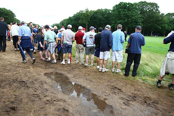 Much of the standing water was removed from the course, but the walkways remained a muddy mess.